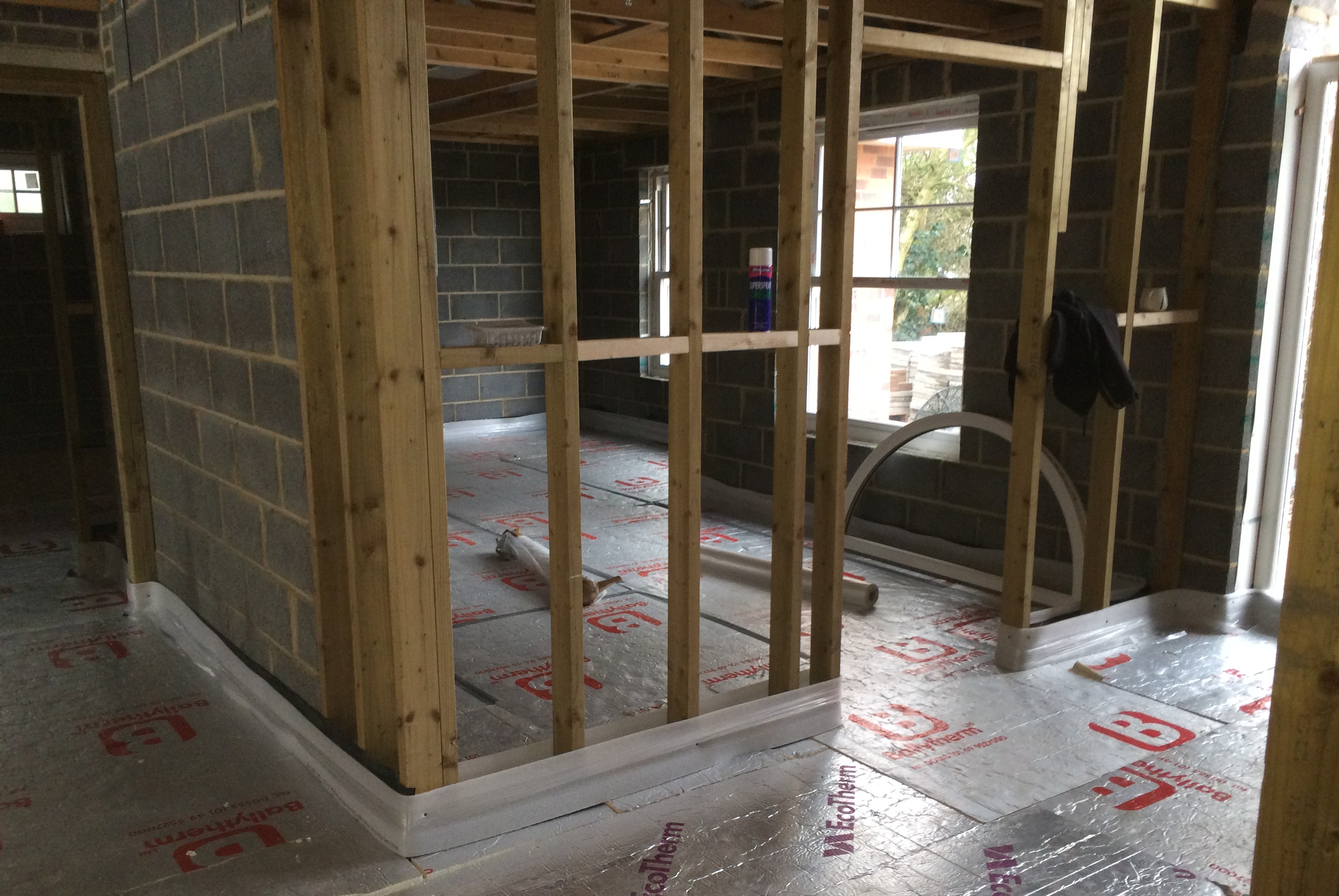 A room with exposed floor insulation prior to screeding.